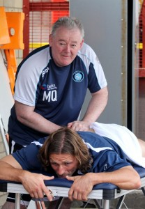 Image of Mick Quin preforming a sports massage | Quinntessential Sports Therapy
