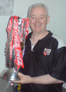 Image of Mick holding a trophy | Sports Therapy in Surrey
